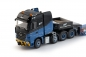 Preview: IMC Models 33-0058 H2 International Mercedes Benz Arocs Bigspace 8x4 with Goldhofer 3 axle low loader